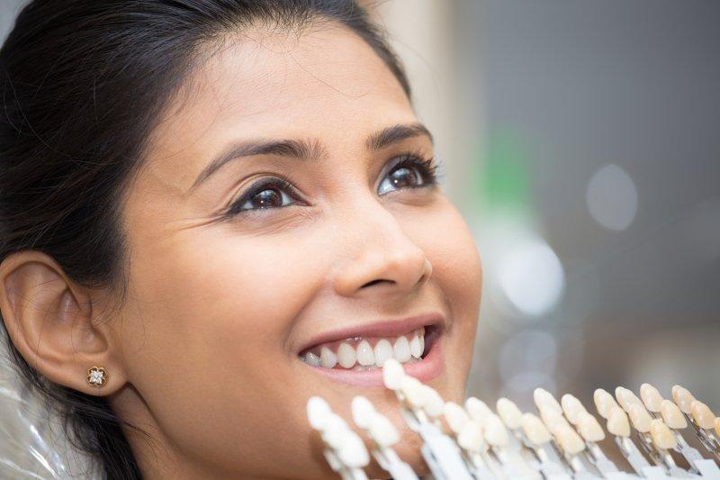 Woman getting veneers from cosmetic dentist in Jupiter
